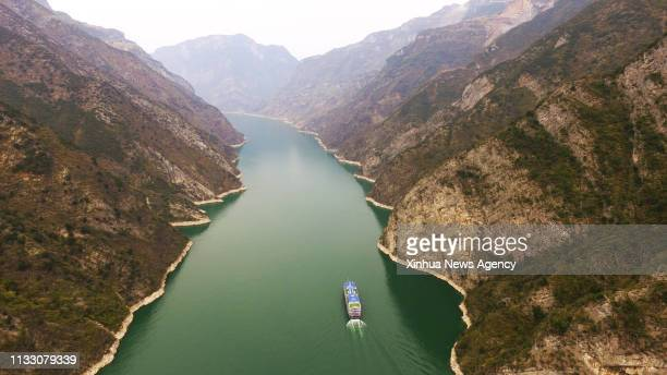 Ship sails in the Wuxia Gorge, one of the Three Gorges on the Yangtze River, in Wushan County, southwest China's Chongqing Municipality, March 26,...