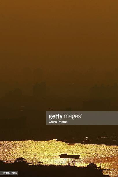 A ship sails on the Huangpu River on December 18 2006 in Shanghai China According to state media China's gross domestic product is estimated to...