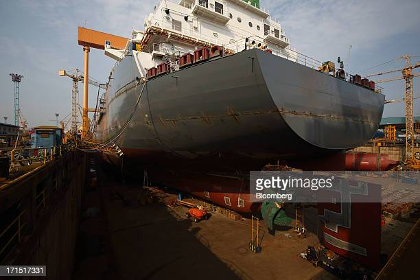 A ship sits under construction in a dry dock at the Daewoo Shipbuilding Marine Engineering Co shipyard in Geoje South Korea on Monday June 24 2013 An...