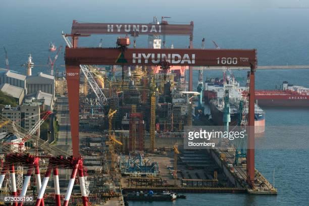 Ship sits under construction in a dry dock at the Hyundai Heavy Industries Co. Shipyard in Ulsan, South Korea, on Sunday, April 23, 2017. Hyundai...