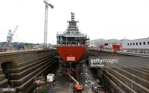 A ship sits under repair in the dry dock at the Cammell Laird shipyard in Birkenhead UK on Thursday June 24 2010 Cammell Laird Holdings Plc is the...