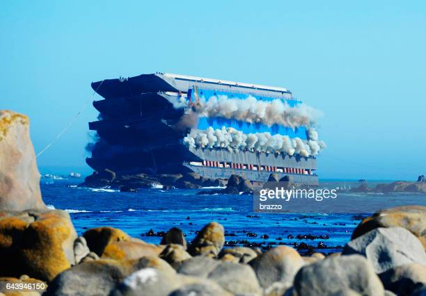 ship smokes before exploding at sea - stranded stock photos and pictures
