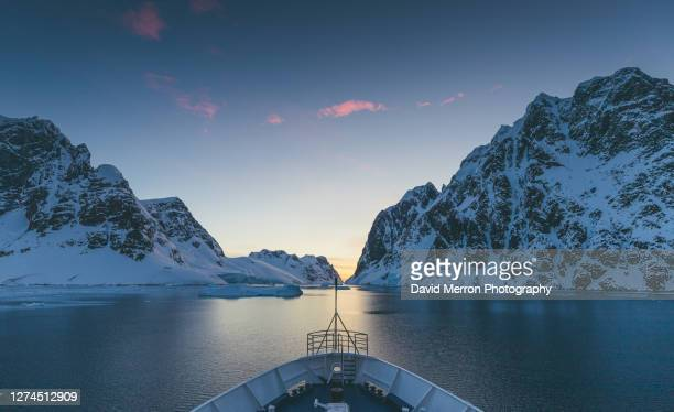 ship sunset cruise on the antarctic peninsula - antarctica stock pictures, royalty-free photos & images