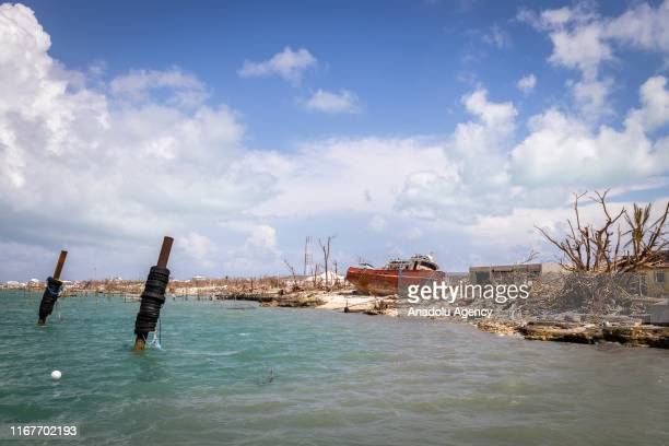 Ship that was pushed up near the road from a storm surge is seen in Marsh Harbour on September 10, 2019 in Grand Bahama, Bahamas. The official death...