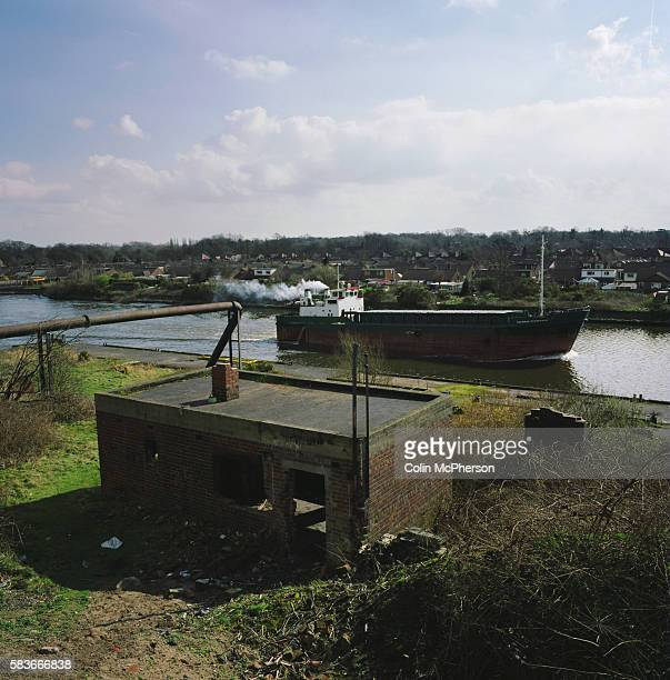 A ship travels along the Manchester Ship Canal at Thelwall en route to the river Mersey and the Irish Sea The Mersey is a river in north west England...