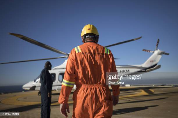 A ship worker prepares to board a helicopter aboard the Mafuta diamond mining vessel operated by Debmarine Namibia a joint venture between De Beers...