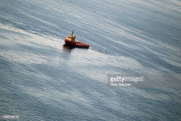 A ship works near the site of the BP Deepwater Horizon oil spill on August 3 2010 in the Gulf of Mexico off the coast of Louisiana BP is to begin...