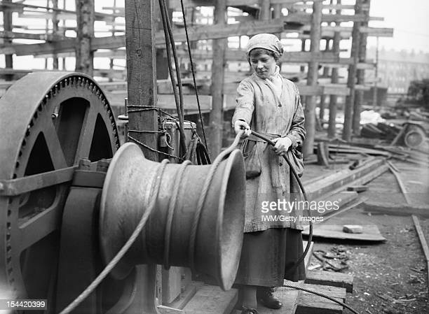 Shipbuilding During The First World War A female worker operates a winch at a shipbuilding yard on the River Clyde in Scotland during the First World...