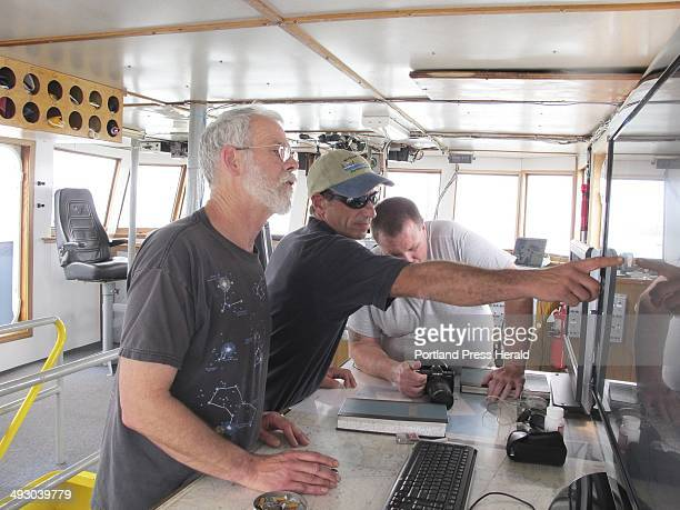 Shipmaster Kevin Garthwaite left and Captain Gary Esper plots the course to a new anchorage for the Sea Hunter this morning Thursday March 4 2010...