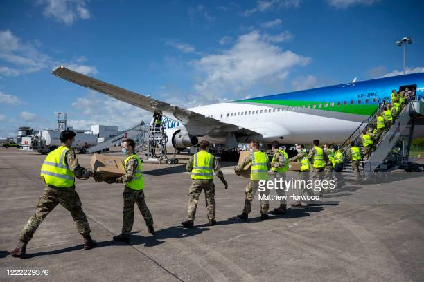 Shipment of PPE from Hangzhou, China, is unloaded by the military from a Pegas Fly plane at Cardiff Airport on May 1, 2020 in Cardiff, Wales. The...