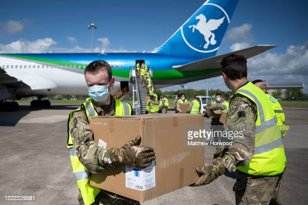 A shipment of PPE from Hangzhou China is unloaded by the military from a Pegas Fly plane at Cardiff Airport on May 1 2020 in Cardiff Wales The plane...