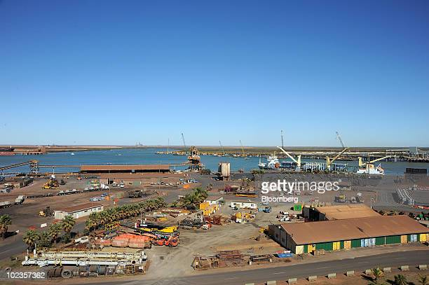 Shipping berths belonging to Rio Tinto BHP Billiton and Atlas Iron Ltd operate sidebyside in Port Hedland Western Australia on Wednesday June 23 2010...