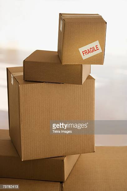 shipping box with fragile sticker on top of stack - fragile sticker stock pictures, royalty-free photos & images