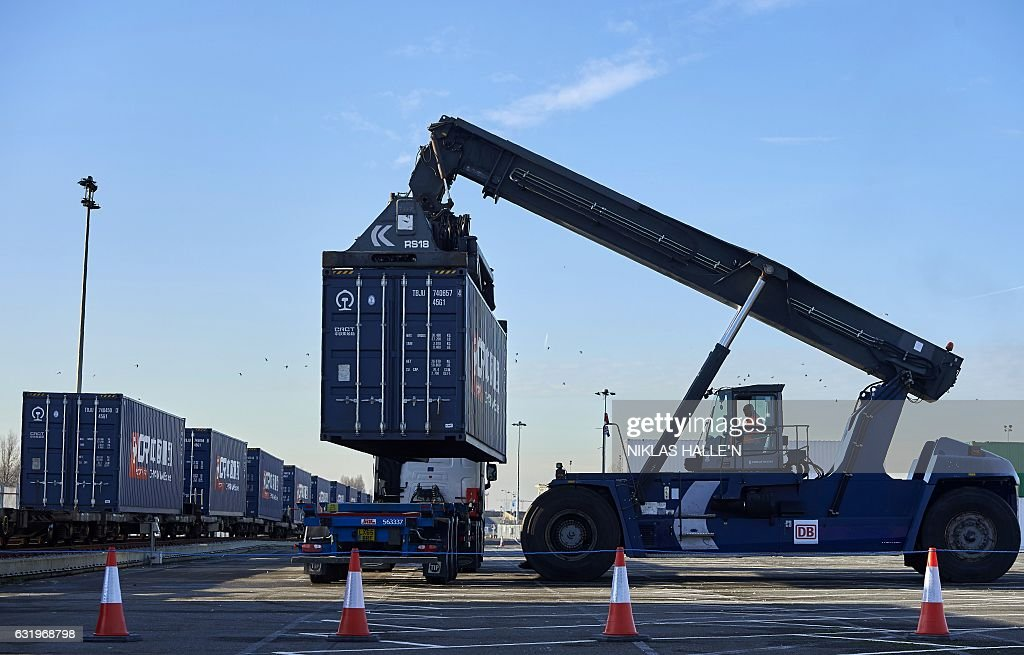 A shipping container containing goods from China is loaded onto a truck after being unloaded from a freight train at DB Cargo's London Eurohub rail freight depot in Barking, east London on January 18, 2017, after the train arrived from Yiwu in the eastern Chinese province of Zhejiang. After a journey of 18 days and 12,000 kilometers, the first freight train directly connecting China to the United Kingdom arrived on Wednesday in London. The journey demonstrates Beijing's desire to strengthen its commercial links to Western Europe by reviving the ancient Silk Road, which was used to transport precious merchandise to the Old Continent. / AFP / NIKLAS HALLE'N