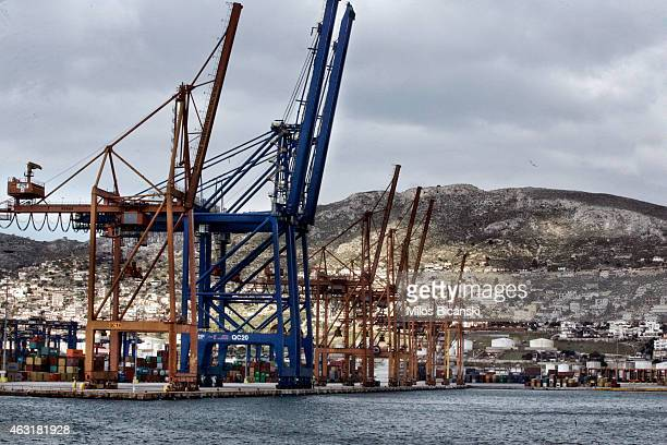 Shipping container cranes line the Pireaus cargo port on February 11, 2015 in Pireaus, Greece. The assent of the new radical Syriza government...