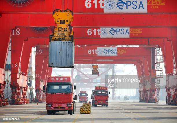 Shipping container is loaded onto a truck at Lianyungang port on February 3, 2021 in Lianyungang, Jiangsu Province of China.