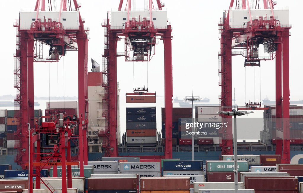 A shipping container is loaded onto a vessel at the Yangshan Deep Water Port in Shanghai, China, on Thursday, Jan. 31, 2013. China's economic growth accelerated for the first time in two years as government efforts to revive demand drove a rebound in industrial output, retail sales and the housing market. Photographer: Tomohiro Ohsumi/Bloomberg via Getty Images