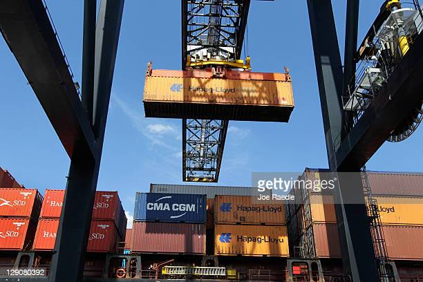 A shipping container is off loaded from a ship at Port Everglades on the day that the United States Congress is scheduled to vote on free trade deals...
