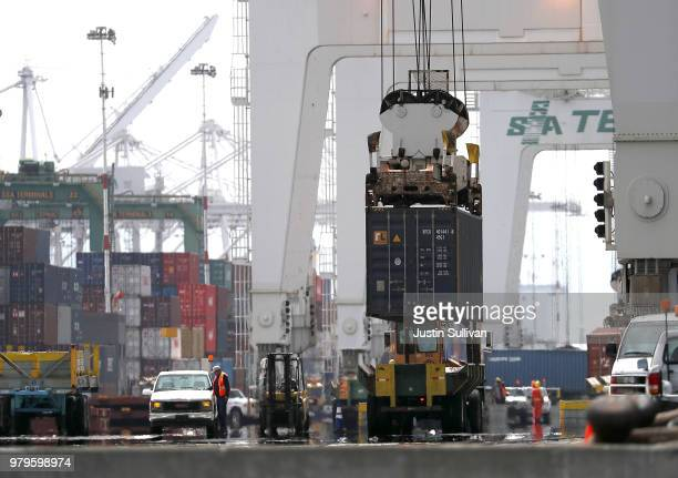 A shipping container is offloaded from the Hong Kong based CSCL East China Sea container ship at the Port of Oakland on June 20 2018 in Oakland...