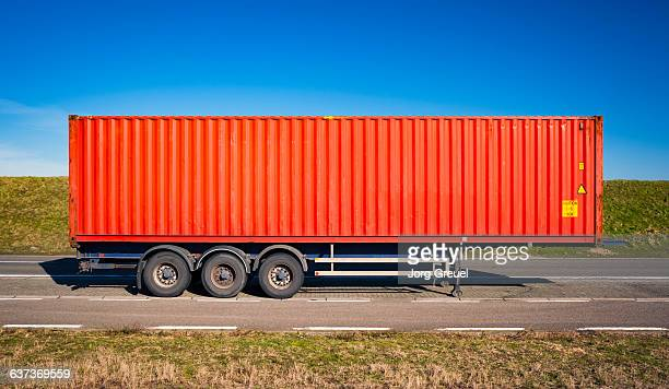 Shipping container on a trailer