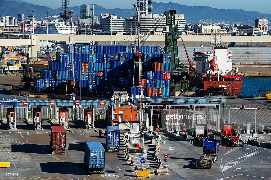 Shipping container transport trucks arrive at a security checkpoint at the commercial port in Barcelona, Spain, on Wednesday, Jan. 29, 2014. Government bonds in Europe's most-indebted countries rallied in the first three weeks of the year on signs the debt crisis that pushed those nations' borrowing costs to euro-era records had abated. Photographer: David Ramos/Bloomberg via Getty Images