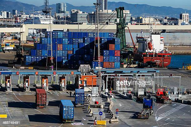 Shipping container transport trucks arrive at a security checkpoint at the commercial port in Barcelona Spain on Wednesday Jan 29 2014 Government...