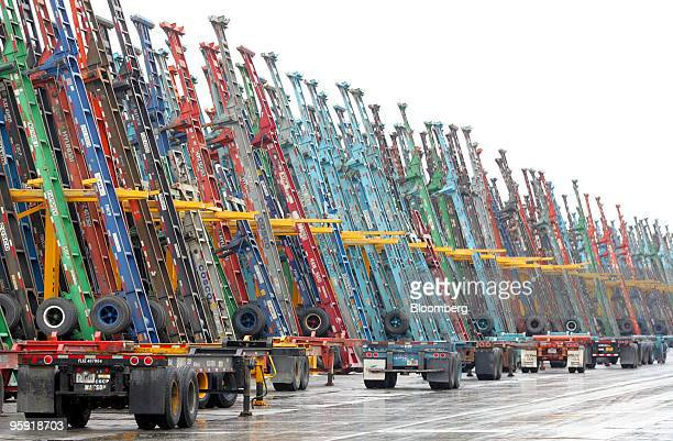 Shipping container truck transport chassis stand idle at the Burlington Northern Santa Fe intermodal freight facility in Elwood Illinois US on...