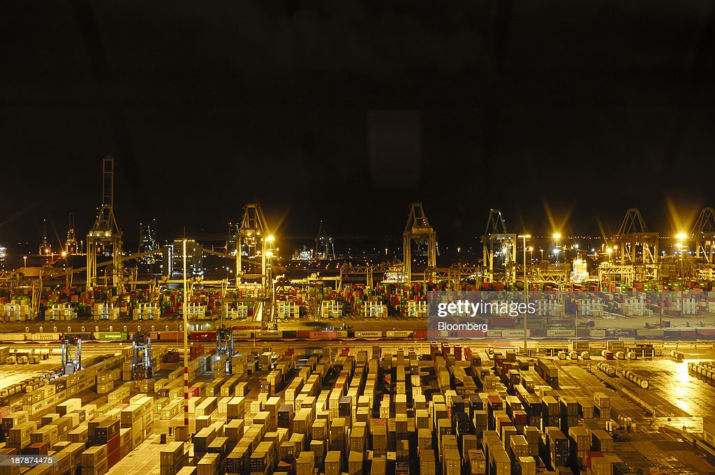 Shipping containers and gantry cranes stand illuminated at night in the Port of Rotterdam seen from the Maersk Mc-Kinney Moeller Triple-E Class container ship, operated by A.P. Moeller-Maersk A/S, in Rotterdam, Netherlands, on Monday, Nov. 11, 2013. A.P. Moeller-Maersk A/S's container-shipping line, the world's largest, reported an 11 percent increase in third-quarter profit after cost cuts countered a decline in freight rates. Photographer: Kristian Helgesen/Bloomberg via Getty Images