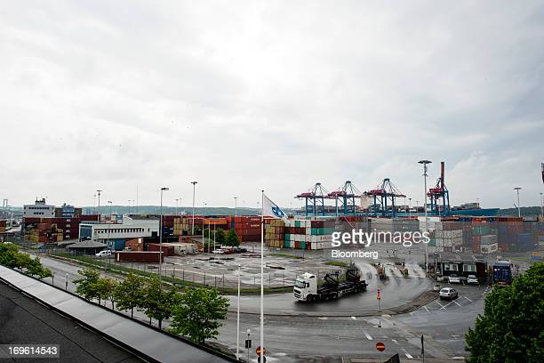 Shipping containers and gantry cranes stand on the dockside at the Port of Gothenburg in Gothenburg Sweden on Tuesday May 28 2013 Sweden's economy...