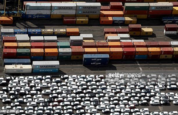 Shipping containers and new automobiles sit on the dockside at the Port of Tilbury operated by Forth Ports Plc in this aerial photograph taken over...