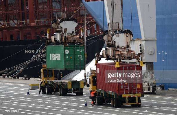 Shipping containers are offloaded from the Hong Kong based CSCL East China Sea container ship at the Port of Oakland on June 20, 2018 in Oakland,...