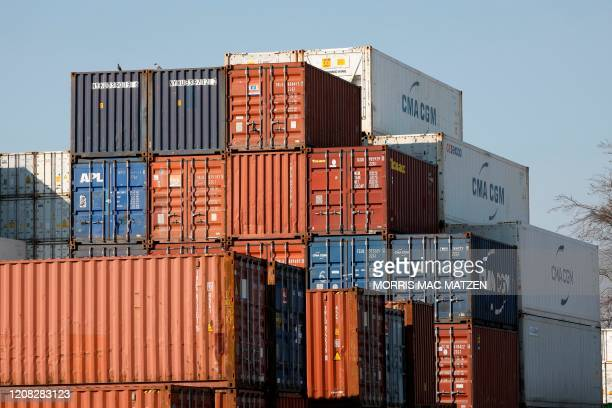 Shipping containers are pictured in a storage and repair center in the harbor of the northern German city of Hamburg on March 26, 2020. - German...
