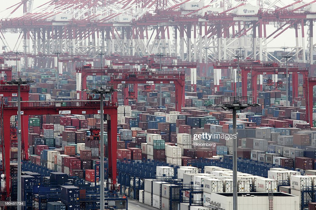 Shipping containers are stacked at the Yangshan Deep Water Port in Shanghai, China, on Thursday, Jan. 31, 2013. China's economic growth accelerated for the first time in two years as government efforts to revive demand drove a rebound in industrial output, retail sales and the housing market. Photographer: Tomohiro Ohsumi/Bloomberg via Getty Images