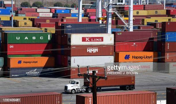Shipping containers are stacked high at the Port of Los Angeles, California on April 19 where records continue to be set for incoming cargo at the...