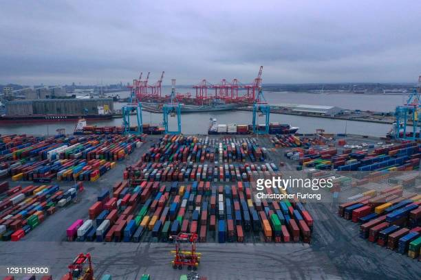 Shipping containers are stacked on the dockside at The Port of Liverpool on December 10, 2020 in Liverpool, United Kingdom. Carriers are reporting a...