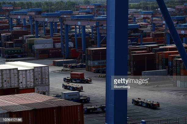 Shipping containers are transported on the dockside by automated guided vehicles at the HLA Container Terminal Altenwerder in the port of Hamburg in...