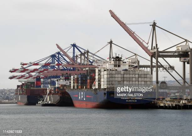 Shipping containers are unloaded at the Port of Los Angeles in Long Beach California on May 14 2019 Global markets remain on red alert over a trade...