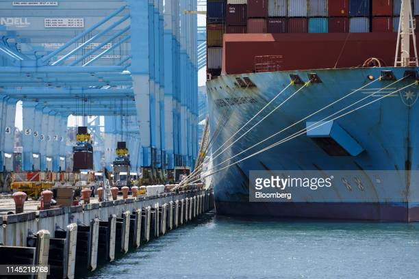 Shipping containers are unloaded from the Maersk Edinburgh cargo ship at the APM shipping terminal in the Port of Los Angeles in Los Angeles...