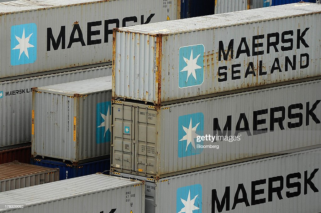 Shipping containers branded Sealand and AP Moller-Maersk A/S stand