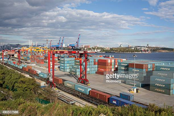 Shipping containers branded with the logo of Fesco Transportation Group sit on the dockside at the Commercial Port of Vladivostok in Vladivostok...