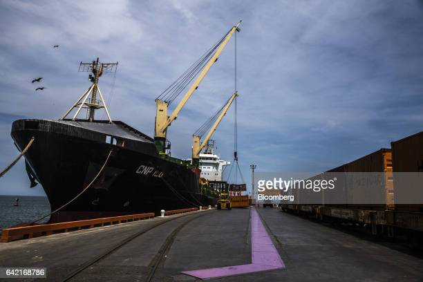 Shipping containers filled with copper plates are loaded onto a ship at the Southern Copper Corp private dock in the Port Terminal of Ilo Peru on...
