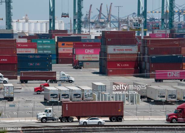 Shipping containers from China and Asia are unloaded at the Long Beach port California on August 1 2019 President Donald Trump announced August 1...