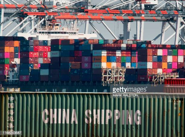 Shipping containers from China and other Asian countries are unloaded at the Port of Los Angeles as the trade war continues between China and the US,...