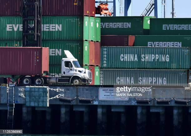 Shipping containers from China and other nations are unloaded at the Long Beach Port in Los Angeles, California on February 16, 2019. - President...