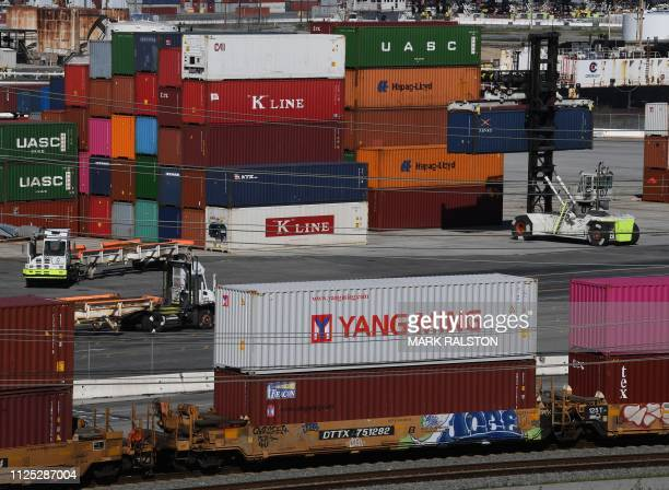 Shipping containers from China and other nations are unloaded at the Long Beach Port in Los Angeles California on February 16 2019 President Donald...