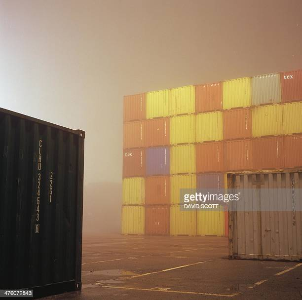 Shipping containers in the fog at night in felixstowe port weather eerie essex film medium format