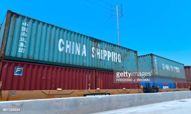 Shipping containers including those of China Shipping a shipping conglomerate under direct administration of China'a State Council await...