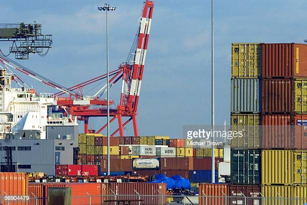 Shipping containers lie stacked upon a yard at Port Newark Container Terminal the thirdlargest cargo terminal in New York harbor on February 21 2006...