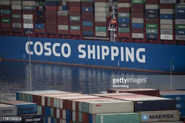 Shipping containers sit aboard a ship at the China Ocean Shipping Co. Ltd. Container terminal at Piraeus port, in Athens, Greece, on Monday, Nov. 11,...
