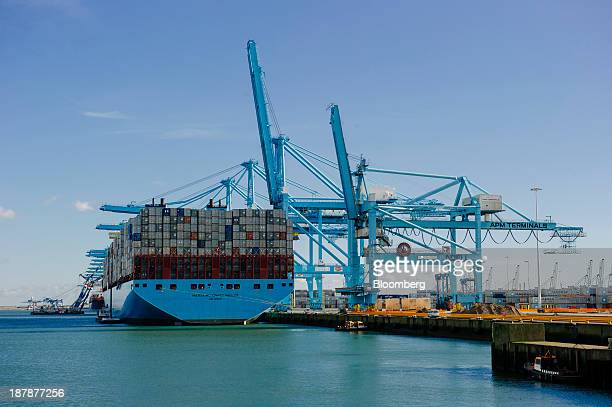 Shipping containers sit aboard the Maersk McKinney Moeller TripleE Class ship operated by AP MoellerMaersk A/S during loading operations at the Port...